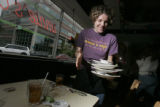 0228 Annie Hastert, 25, a waitress at Annie's Cafe, no relationship, busses a table across the...