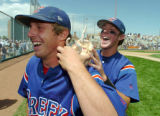 (DENVER, CO., MAY 21, 2004)  Cherry Creek's #3, Brett Sowers, right, places a ceramic gargoyle on...