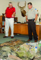 Cortez Police chief Roy Lane, left, and San Juan County, Utah Sheriff Mike Lacy, right, discuss...