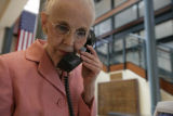Patti Imig (cq) answers a call at the Bob Magness Administrative Sevice Center for the Volunteers...