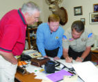 San Juan County, Utah, Sheriff Mike Lacy, right, shows Cortez Police Chief Roy Lane, left, and...