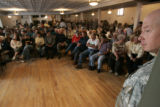 0475 Concerned members of the public attend a meeting held by the U.S. Army LTC James Rice, right,...
