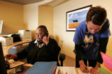 Doris Williams (cq) left, answers the phone as R.N. Jeri Whitfield (cq) fills out paper work at...