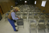 DLM0329  Tony Hass, owner of the Walkin' Y Ranch near Thatcher, sets out chairs for a meeting...
