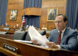 Rep. Ed Perlmutter, D-Colo., goes over notes before the Financial Services Committee hearing he...