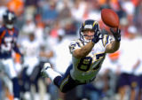 (DENVER, Co., SHOT 9/26/2004) The San Diego Chargers' Tim Dwight (#87, WR) dives for a deep pass...