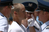 Air Force Academy cadets get in the face of Davis Becker, Thursday June 27, 2007 as he stands at...