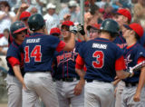 (DENVER, CO., MAY 21, 2004)  Heritage's #14, Chad Murray, second from left, is meet by the team...