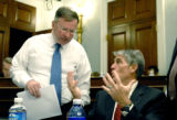 Rep. Doug Lamborn, R-Colo., left, confers with Rep. Mark Udall, D-Colo., right, before the Natural...