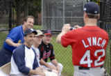 Rep. Ed Perlmutter, D-Colo., left, gets his photo taken with teammates Michael Arcuri, D-N.Y.,...