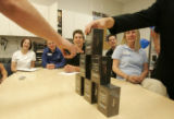 643Sales representatives at the AT&T Park Meadows Store get a preview of the new iPhone as...