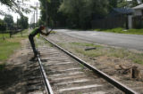 Workers tear up old tracks along 13th street, Friday morning, June 15, 2007, in Lakewood. This is...