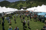 0207 Hundreds of people carouse the Grand Tasting Pavilion Courtyard tasting and sipping food and...