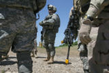 (at center) 37 year-old Major Andrew Olmsted participates on a briefing after a recent training...