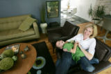 Kristen Tait (cq), plays around with her son, Jackson, 4, in the living room of their home on June...