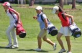 L toR: Jessica Wallace (cq), Jane Rah (cq) and Mina Harigae (cq) walk up the 13th fairway  during...