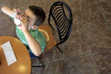 Alec Romo-Nichols (cq), 5, of Denver, Colo., polishes off the last of his Cold Stone ice cream at...
