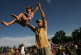 MJM712   Ellie Ross, 3, is thrown up into the air by her father, Jeff Ross (cq) of Denver as they...