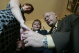 (L-R) Sonya, Ethan and Dave Graalum pray together in their Littleton home Sunday June 17, 2007...