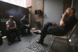left to right, Nina Ross, a manager sits with Antonio Meza, *(not smoking)* and Shaune Walter,...