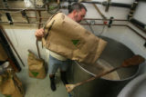 Kevin DeLange, owner and operator of Dry Dock Brewery in Aurora, brews up a German wheat beer,...