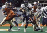 Chicago Rush Defensive Backfield Jonathan Ordway (cq) runs past Colorado Crush (at left) DL...