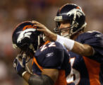 (DENVER, CO., SEPTEMBER 12, 2004)  Jake Plummer congratulates Quentin Griffin on his 25 yard TD...