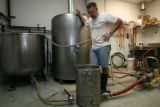 Kevin DeLange, owner and operator of Dry Dock Brewery in Aurora, watches the slow filtering...