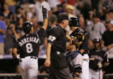 (DS-b-240) - Colorado Rockies catcher Yorvit Torrealba celebrates after crossing home plate...