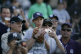 (DS440) - Unidentified fans watch baseballs soar into the outfield as the New York Yankees take...