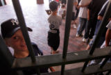 Young Yankee fan Payson Sails (CQ), 11, of Beaver, Utah peeks through the gates at the Blake...