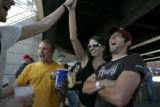 Eric Hobbs (cq) of Littleton, left, high fives Chelsea Twining (cq) at Rockies v. NY Yankees at...