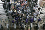 Fans enter Coors Field in Denver through gate C at the Colorado Rockies' game against the New York...