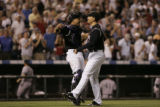 Rockies catcher Yorvit Torrealba and relief pitcher Brian Fuentes celebrate after stricking out...
