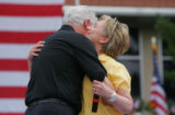 Hillary Clinton hugs her husband former President Bill Clinton at a campaign event at the...
