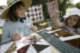 Danielle Magri, 4, pulls a needle and thread while quilting during the Old Fashioned 4th of July...