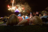 374 Michael Vandersanden, CQ, 5, of Aurora, watches fireworks with his family during the Fourth of...