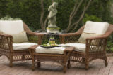 SH07G010HOMESTYLE July 2, 2007 -- This outdoor wicker, with seats covered in duck-cloth fabric,...