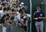 Fans reach out to Yankee pitcher Roger Clemens in hopes of a autograph before game two of the...