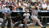 (JOE1095) -  New York Yankees batter Hideki Matsui, right, strikes out swinging to end the sixth...