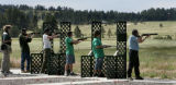 Boy Scouts fire shotguns on clay targets at Peaceful Valley Scout Ranch in Elbert County, Colo.,...