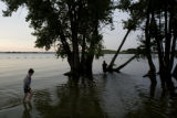 DLM1724  Erick Krier, 9, wades out into the shallows at the swim beach at North Sterling Reservoir...