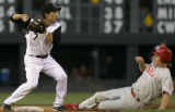 Colorado ROckies second baseman Kazuo Matsui (7) looks to first base after getting Philadelphia...