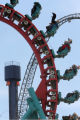 "Thrill seekers ride the ""Mind Eraser"" (at right) at Denver's Elitch Gardens, as the..."