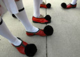 Greek dancers wear the traditional Tsarouhia shoe before taking the stage with Pedakia a dance...