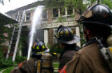 DENVER, CO MAY 21,2004  Denver firefighters put water on a multi-story building near 8th Street...