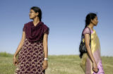 Mounika Chilakuri(cq), left, and her sister Nikhila Chilakuri(cq) watch for cars arriving for the...