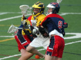 Denver, Colo., photo taken May 21, 2004- Arapahoe's Logan Bobzien (center yellow #1)  gets caught...