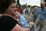 DLM0389  Sonji Wilkes, left, holds her son Thomas, 3, and waits with her husband Nathan Wilkes,...