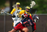 Denver, Colo., photo taken May 21, 2004- Arapahoe's Kevin Bush (center yellow #8) defends Kent...